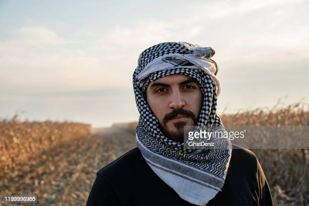 portrait of a farm worker wearing peshmerga - kaffiyeh stock pictures, royalty-free photos & images