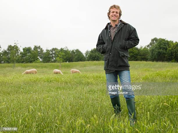 portrait of a farmer   - staan stockfoto's en -beelden