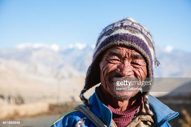 portrait of a farmer, upper mustang region, nepal - nepal stock pictures, royalty-free photos & images