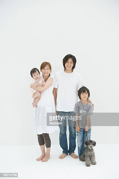 portrait of a father, a mother and a son - 子供2人の家庭 ストックフォトと画像