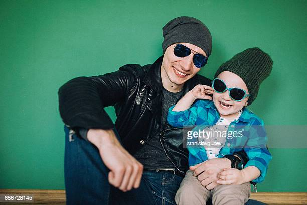Portrait of a father and daughter wearing sunglasses and beanies