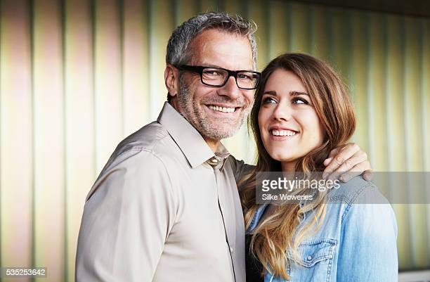 portrait of a father and his young adult daughter
