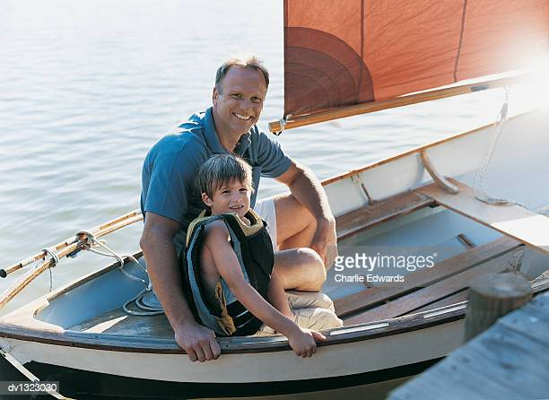 Portrait of a Father and Son Sitting in a Sailing Boat