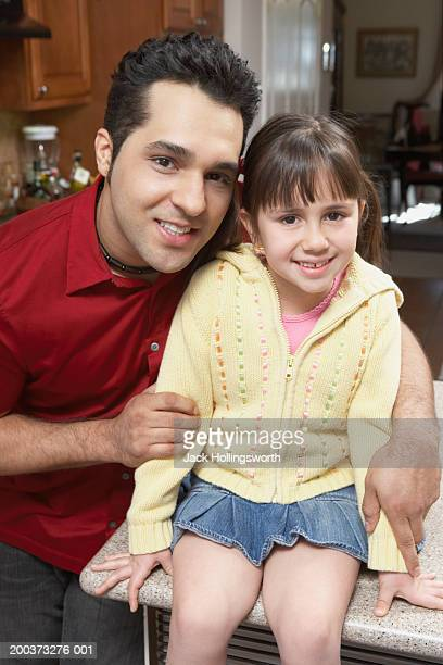Portrait of a father holding his daughter
