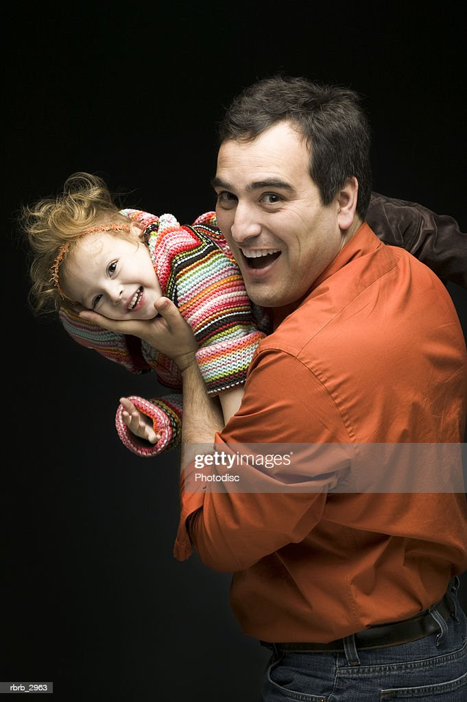 Portrait of a father playing with his daughter : Foto de stock