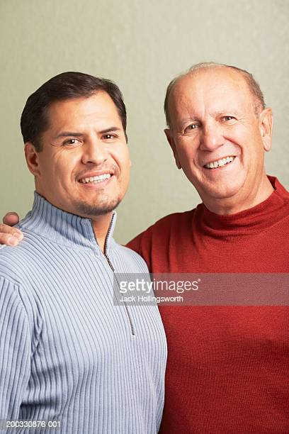 portrait of a father with his son smiling - endast vuxna bildbanksfoton och bilder