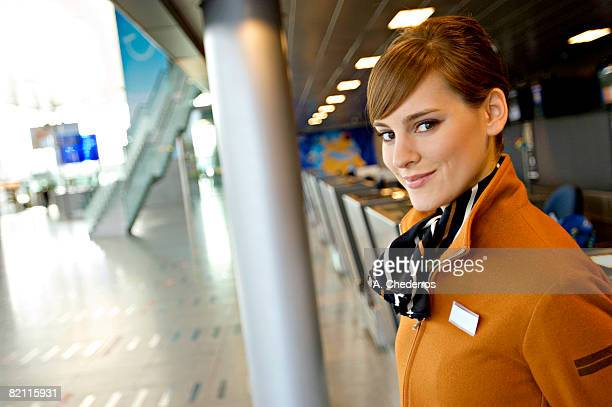 Portrait of a female airline check-in attendant smiling