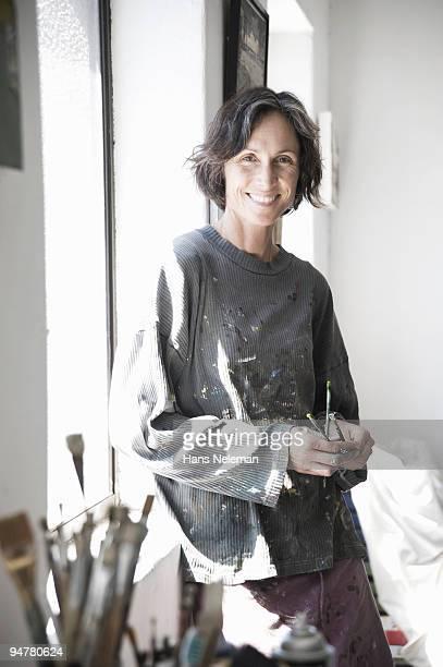 Portrait of a female artist in an art studio, Cape Town, South Africa