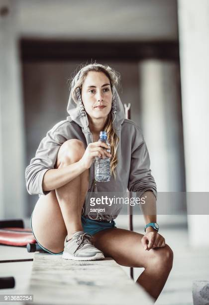 Portrait of a Female Athlete Resting, Drinking Water