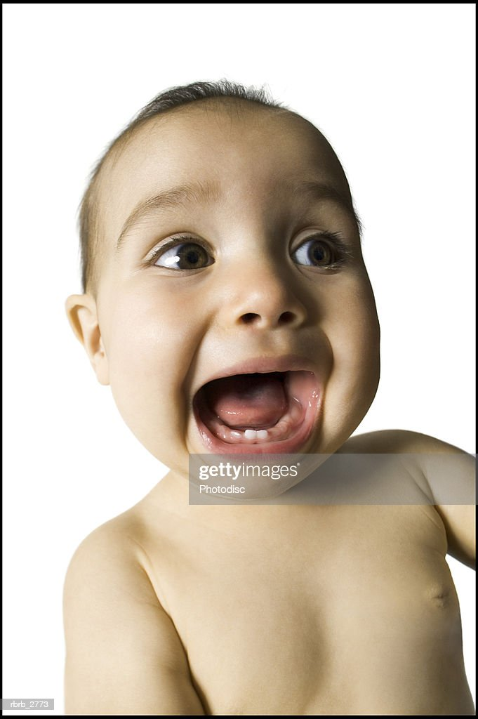 portrait of a female baby as she screams with delight : Foto de stock