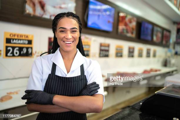 portrait of a female business standing with arms crossed in a butchers shop - pardo brazilian stock pictures, royalty-free photos & images