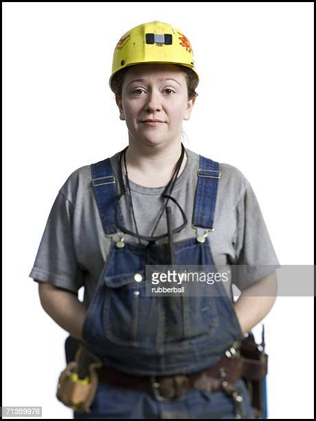 Portrait of a female coal miner standing with her hands in her pockets