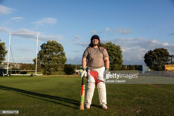 portrait of a female cricket player in the evening light - cricket player stock pictures, royalty-free photos & images