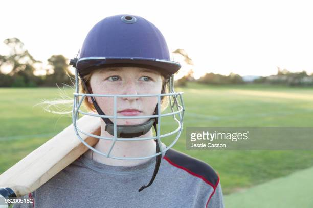portrait of a female cricketer wearing protective helmet - cricket player stock pictures, royalty-free photos & images