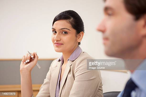 Portrait of a female executive in a meeting