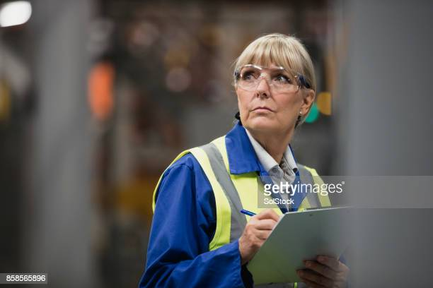 portrait of a female factory surveyor - protective workwear stock pictures, royalty-free photos & images