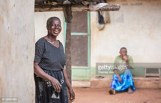Portrait of a female farmer on her cashew farm in Ghana In the background sits an older woman in front of her house on September 06 2016 in Congo...