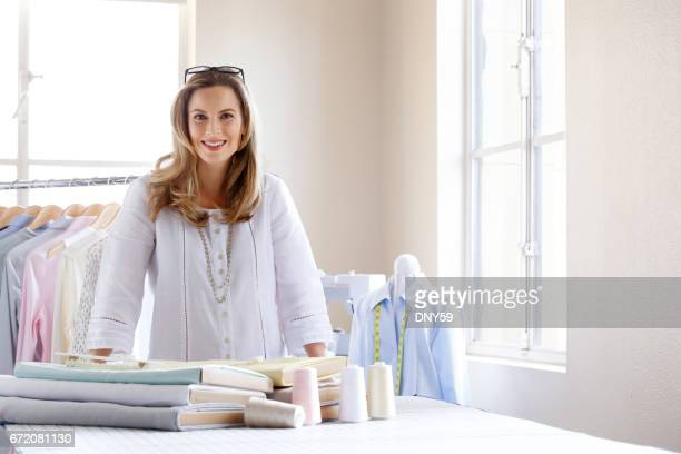 Portrait Of A Female Fashion Designer In Her Design Studio