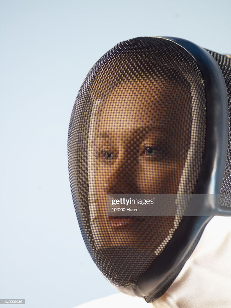 Portrait of a Female Fencer With a Mask Over Her Face : Stock Photo