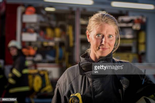 portrait of a female firefighter - firefighter stock pictures, royalty-free photos & images