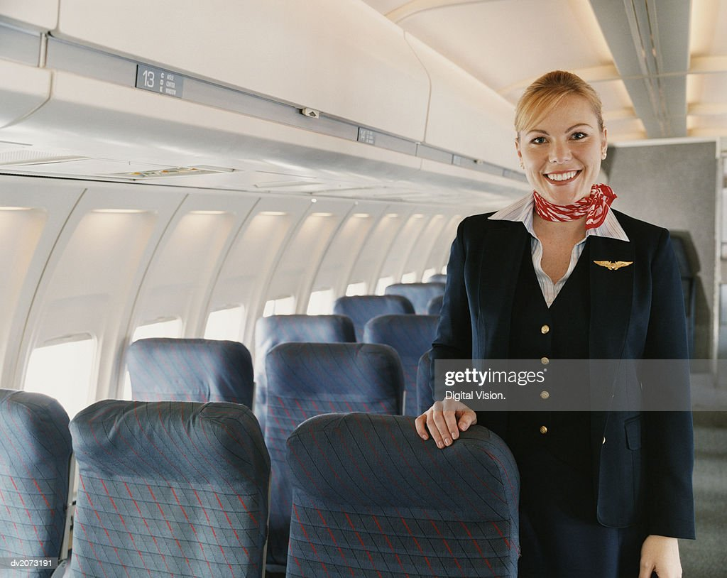 Portrait of a Female Flight Attendant on a Plane : Stock Photo
