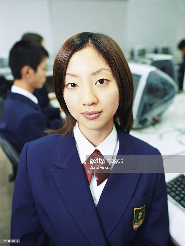 Portrait of a Female High School Student in a Computer Classroom : Stock Photo