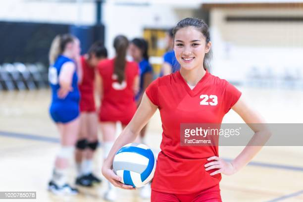 portrait of a female high school volleyball player - volleyball stock pictures, royalty-free photos & images