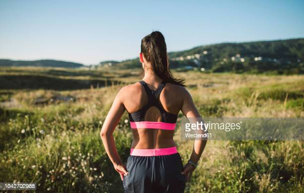 portrait of a female jogger, rear view - human back stock photos and pictures