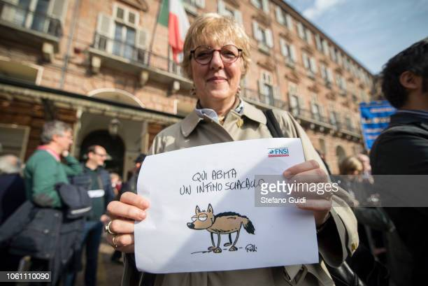 Portrait of a female journalist holding a protest sign in her hand with the words 'Here a very poor jackal lives' during the journalists' protest...