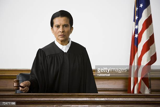 portrait of a female judge holding a gavel - judge law stock pictures, royalty-free photos & images