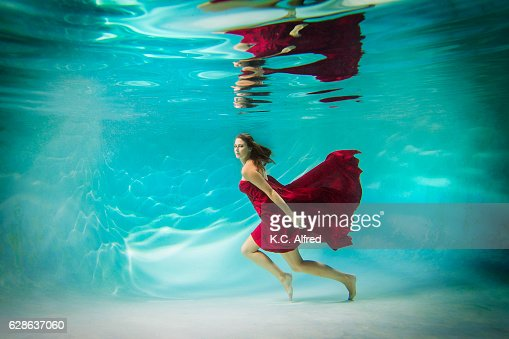 Portrait Of A Female Model Underwater In A Swimming Pool In San Diego California Stock Photo