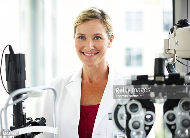 portrait of a female opthamologist - optometry stock photos and pictures