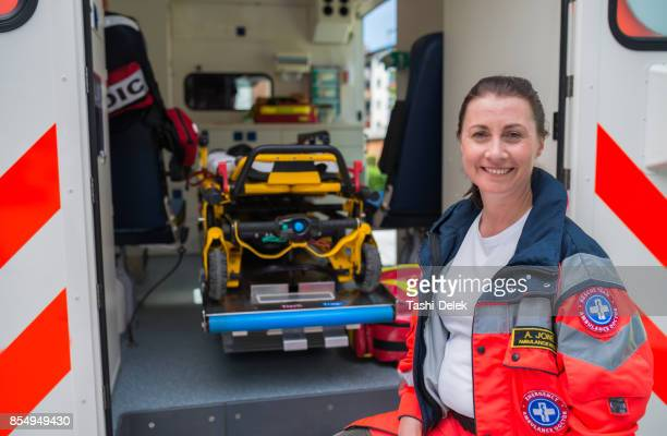 portrait of a female paramedic - rescue worker stock pictures, royalty-free photos & images