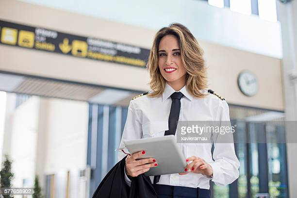 Portrait of a female pilot in the airport