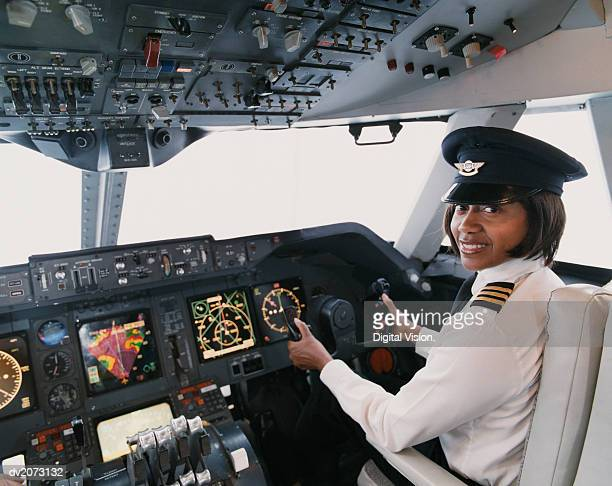 portrait of a female pilot sitting in the cockpit - piloting stock pictures, royalty-free photos & images