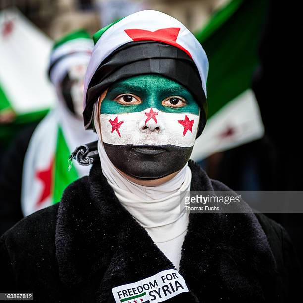 Portrait of a female protester wearing the Syrian freedom flag at the 1st Anniversary March for the Syrian Revolution, London, March 2012.