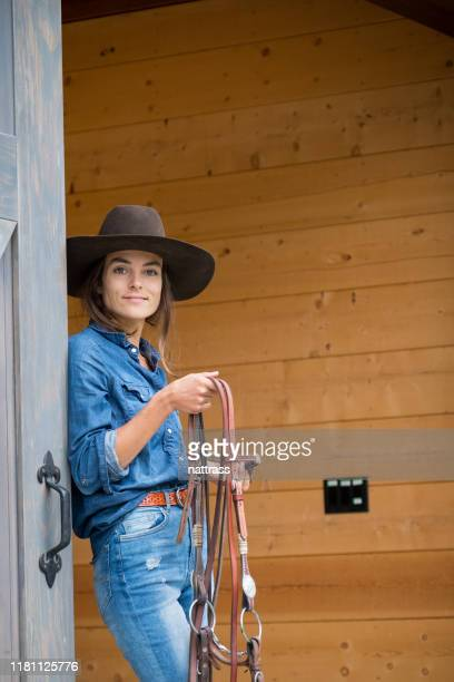 portrait of a female rancher - rein stock pictures, royalty-free photos & images