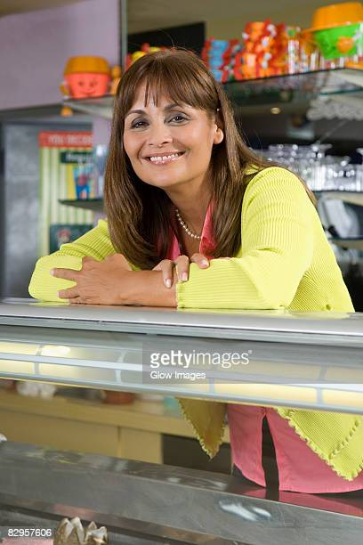 Portrait of a female sales clerk smiling at an ice cream counter
