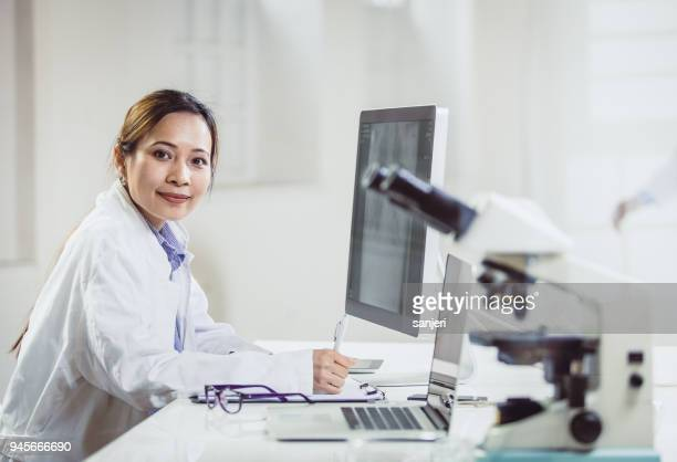 portrait of a female scientist in the laboratory - vietnamese ethnicity stock pictures, royalty-free photos & images