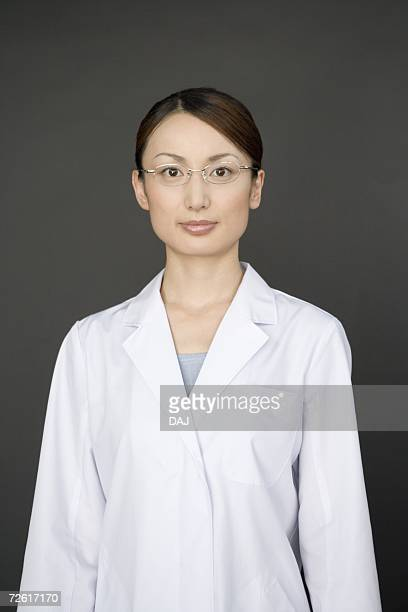 Portrait of a female scientist, looking at camera, front view, black background