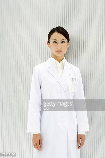 Portrait of a female scientist, looking at camera, front view