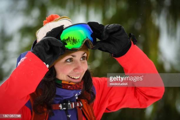 portrait of a female snowboarder - british columbia stock pictures, royalty-free photos & images