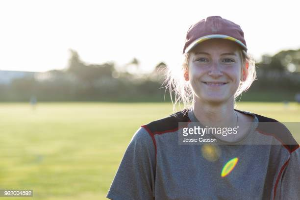 portrait of a female sports player on sports field with the sun behind her - reportage stock pictures, royalty-free photos & images