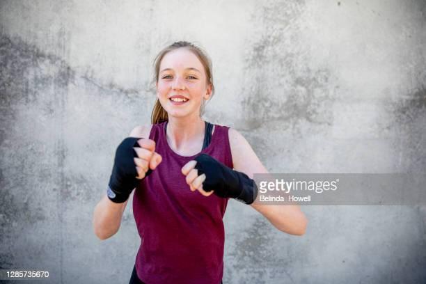 portrait of a female, teenage martial arts fighter - artes marciales fotografías e imágenes de stock