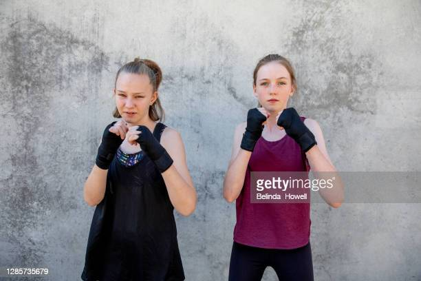 portrait of a female, teenage martial arts fighters posing together - showus stock pictures, royalty-free photos & images
