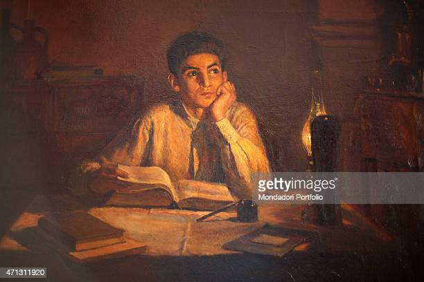 A portrait of a fifteen years old Joseph Stalin studying at night at the light of an oil lamp while looks up thoughtfully ahead is displayed in the...