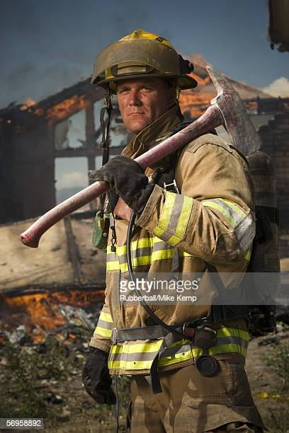 Portrait of a firefighter holding an axe