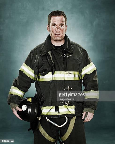 portrait of a firefighter - beschermende werkkleding stockfoto's en -beelden