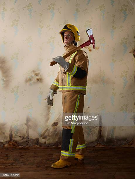 portrait of a fireman - firefighter stock pictures, royalty-free photos & images