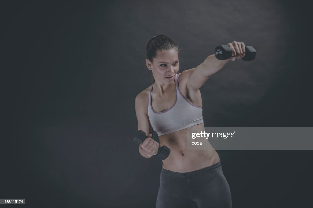 0db86b19 Portrait Of A Fit And Toned Woman Wearing A Sports Bra Stock Photo ...